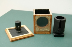 Image shows all three components; clock and shutter, pinhole camera attached to roof of nestbox (upside down) and the nestbox. Copyright Anthony Carr