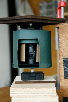 Image shows both top and bottom shutter mechanisms sitting inside one another, including the pinhole camera (as they would be inside the nestbox). Copyright Anthony Carr