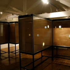 FORMAT 11 exhibition at Pickford's House Museum, Derby. Image shows large wooden nestbox-like cases in a maze-like formation. The photographs were inserted into the cases and the holes allowed visitors to peer in. Copyright Anthony Carr