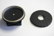 Image shows clock, and both top and bottom caps used in rotating light-box mechanism. Copyright Anthony Carr