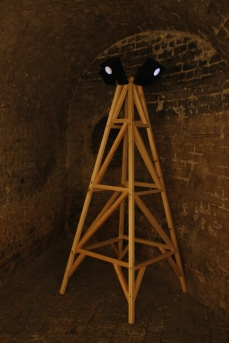 Moonlight Tower (Square) in Lumen exhibition, at the Crypt Gallery, London, Dec 2014. Image shows a wooden tower with four low lux moonlight light-boxes at the top. Copyright Anthony Carr
