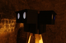 Moonlight Tower (Triangle) in Lumen exhibition, at the Crypt Gallery, London, Dec 2014. Image shows close up of wooden tower with six low lux moonlight light-boxes at the top. Copyright Anthony Carr