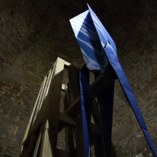 Blue Streak installed in the ice-house at Burghley Sculpture Garden, attached to a large 4m tall Moonlight Tower. Copyright Anthony Carr